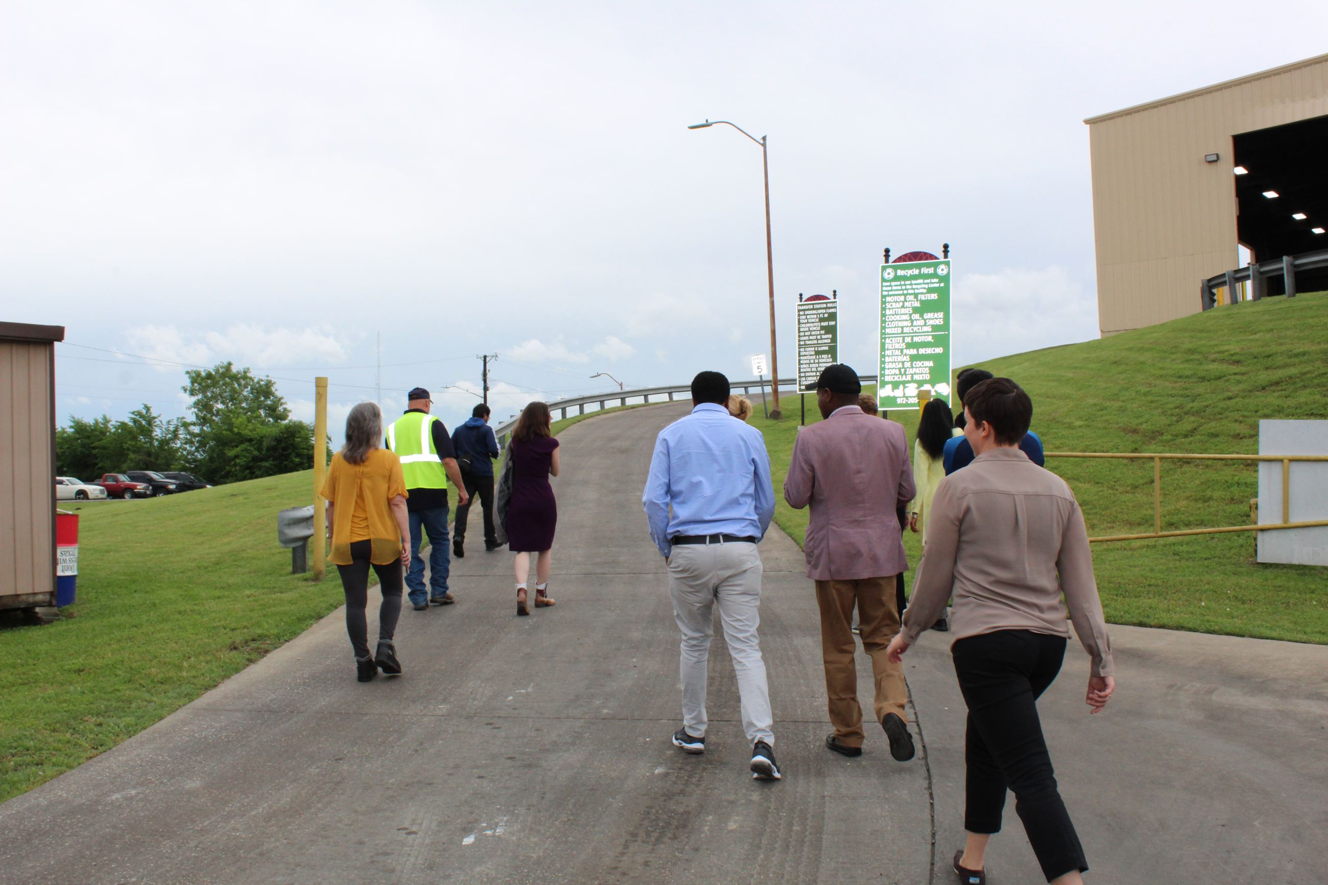 Visitors get a tour of the Garland Transfer Station